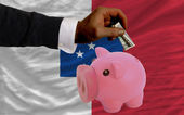Dollar into piggy rich bank and national flag of of francevill — Stock Photo