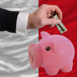 Dollar into piggy rich bank and  national flag of malta - ストック写真