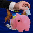 Dollar into piggy rich bank and  flag of american state of michi - Stock Photo