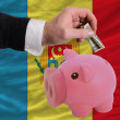 Dollar into piggy rich bank and  national flag of moldova - Stock Photo
