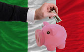 Dollar into piggy rich bank and national flag of italy — Стоковое фото