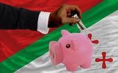 Dollar into piggy rich bank and national flag of of katanga — Stock Photo