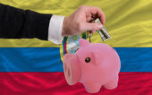Dollar into piggy rich bank and national flag of ecuador — 图库照片