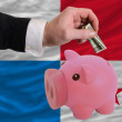 Dollar into piggy rich bank and  national flag of panama — Стоковая фотография