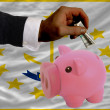 Dollar into piggy rich bank and  flag of american state of rhode - Stock Photo