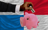 Dollar into piggy rich bank and national flag of panama — Stock fotografie