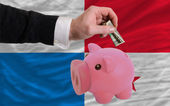 Dollar into piggy rich bank and national flag of panama — Stock Photo