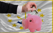 Dollar into piggy rich bank and flag of american state of rhode — Stock Photo