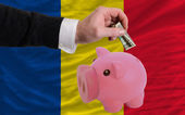 Dollar into piggy rich bank and national flag of romania — Stock Photo