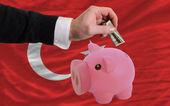 Dólar em piggy bank rico e bandeira nacional da turquia — Foto Stock