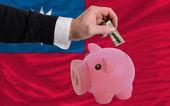 Dolar w piggy bank bogaty i flagi narodowej z tajwanu — Zdjęcie stockowe