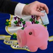 Funding euro into piggy rich bank flag of american state of conn - Stock fotografie