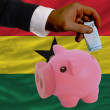 Funding euro into piggy rich bank national flag of ghana - Стоковая фотография