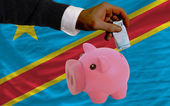 Finansiering euro i piggy rika bank nationella flagga i kongo — Stockfoto