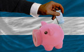 финансирование евро в богатые свинка банка национальный флаг сальвадора — Стоковое фото