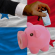 Funding euro into piggy rich bank national flag of panama — Stock Photo
