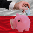 Funding euro into piggy rich bank national flag of poland — Stock Photo