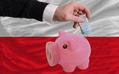 финансирование евро в богатые свинка банка национальный флаг польши — Стоковое фото