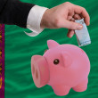 Funding euro into piggy rich bank national flag of turkmenistan - Stock Photo