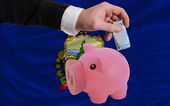 Funding euro into piggy rich bank flag of american state of verm — Stock Photo