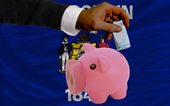 Funding euro into piggy rich bank flag of american state of wisc — Стоковое фото