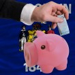 Funding euro into piggy rich bank flag of american state of wisc - Lizenzfreies Foto