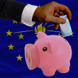Funding euro into piggy rich bank flag of american state of indi - Stock fotografie