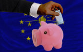 Funding euro into piggy rich bank flag of american state of indi — Foto de Stock