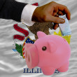 Funding euro into piggy rich bank flag of american state of illi - Stock Photo
