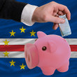 Funding euro into piggy rich bank national flag of  of capeverde - Stock Photo