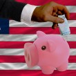 Funding euro into piggy rich bank national flag of liberia - Stock Photo