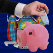 Funding euro into piggy rich bank flag of american state of new - Stock Photo