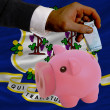 Funding euro into piggy rich bank flag of american state of conn - Zdjcie stockowe