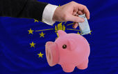 Funding euro into piggy rich bank flag of american state of indi — Stock Photo