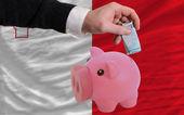 Funding euro into piggy rich bank national flag of malta — Stock Photo