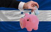 Finansowanie euro bogaty piggy bank flaga narodowa hondurasu — Zdjęcie stockowe
