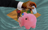 Funding euro into piggy rich bank flag of american state of dela — Stock Photo