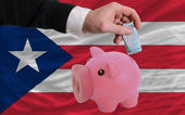 Funding euro into piggy rich bank national flag of puertorico — 图库照片