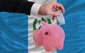 финансирование евро в богатые свинка банка национальный флаг гватемалы — Стоковое фото