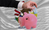Funding euro into piggy rich bank flag of american state of illi — Stock Photo