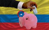 финансирование евро в богатые свинка банка национальный флаг колумбии — Стоковое фото