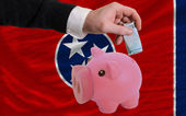 Funding euro into piggy rich bank flag of american state of tenn — Stock Photo