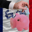 Funding euro into piggy rich bank flag of american state of iowa - Stock Photo