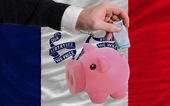 Funding euro into piggy rich bank flag of american state of iowa — Stock Photo