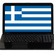 Laptop computer with national flag of greece — Stock Photo #24935211