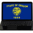 Laptop computer with  flag of american state of oregon — Stock Photo