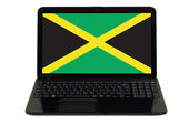 Laptop computer with national flag of jamaica — Stock Photo