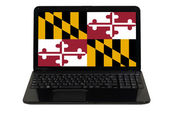Laptop computer with flag of american state of maryland — Stock Photo