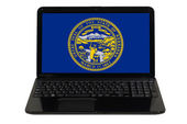 Laptop computer with flag of american state of nebraska — Stock Photo