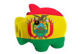 Piggy rich bank in colors national flag of bolivia for savin — Stock Photo